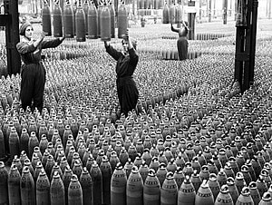 Photograph of 2 women workers handling shell munitions at Chilwell