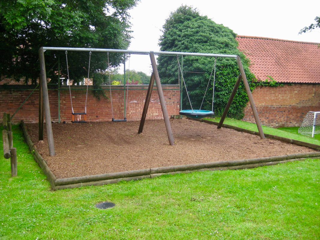 Photograph of children's swings in Granby.